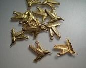 12 small brass hummingbird charms
