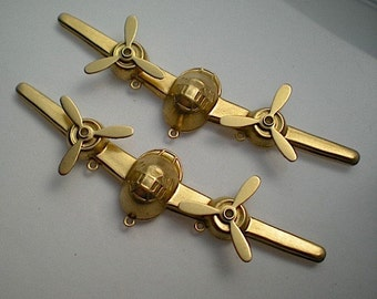 2 extra large airplane charms with propellers