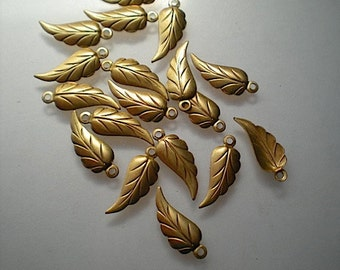 18 tiny brass leaf charms, No. 1