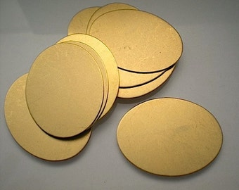 12 large flat brass oval discs/stamping blanks