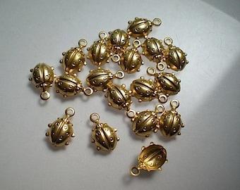 18 tiny brass ladybug charms