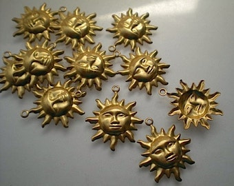 12 brass sun charms