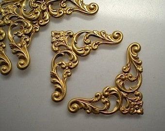 6 small brass floral corner brackets, No. 1