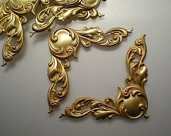 6 large brass ornate corner brackets