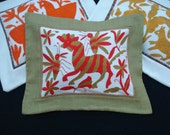 Embroidered pillow P106  A confused zebra disturbed by wasps while walking a tropical garden