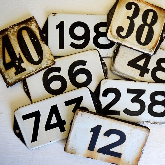 vintage enamel house number from Europe, number 12 black on white with great patina