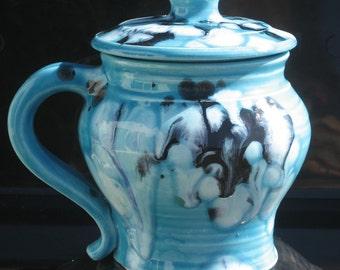 small covered mug, blue
