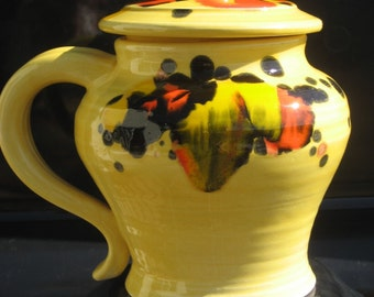 covered mug, yellow