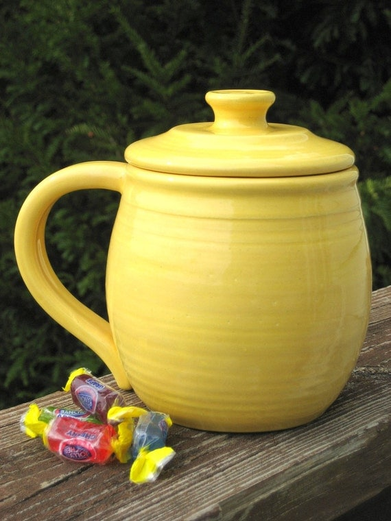 large covered mug, yellow