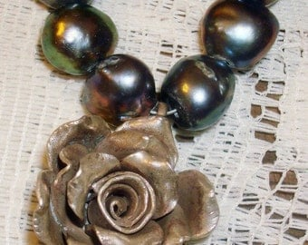 Hill tribe silver rose from thailand made with irradiated pearls