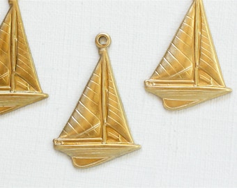 12 brass SAILBOAT jewelry charms . 23mm x 15mm (ST58). Please read description