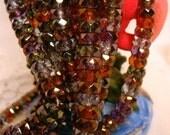 6mm (1 strand) of lumi rondell bead mix