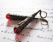 Red crystal and brass cone dangle earrings.  Dragon's claw.