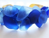 Cobalt blue beach glass bracelet.  Cuff bracelet.  In brass.