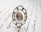 Faux white pearl cocktail ring in romantic silver filigree setting