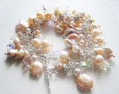 Pink pearl bracelet.  Charm bracelet.  Freshwater pearls, crystal, and silver.
