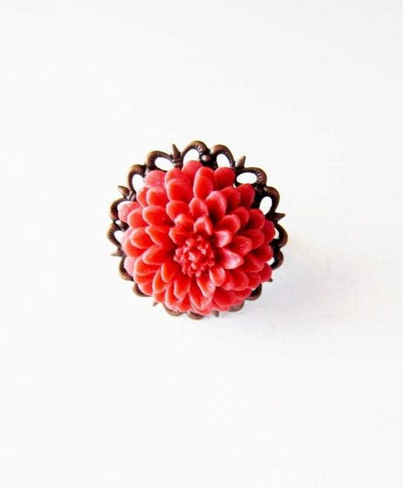Burnt orange flower ring on bronze lace.  Victorian romance.