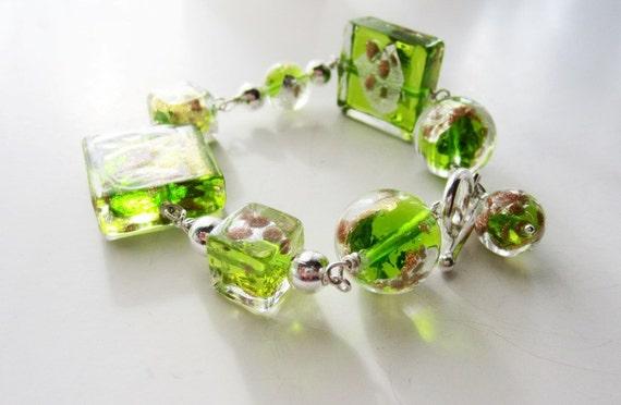 Green glass bracelet.  Venetian glass lampwork.  Wire wrapped sterling silver.