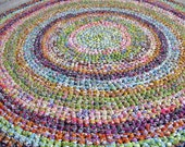 Unique and rare handmade vintage / antique round crocheted rag rug from estate. Rings of bright colors. Circa early to mid 1960's.