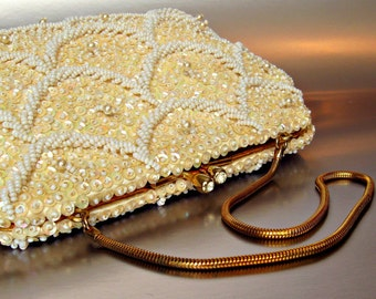 Vintage evening bag. Elaborately beaded w/ gold snake chain. Antique ivory with sequins, beads, pearls. C 1950, 1960.