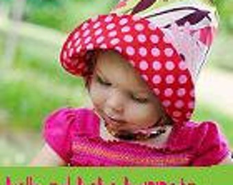 GYPSY ROSE, a reversible sun bonnet in magical pinks, browns, and greens, from Bella Sol Bebe