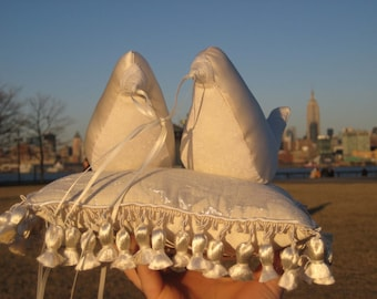 Pair of Ivory Ring Birds on a Pillow