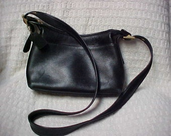 Black leather Coach purse- can wear cross body- nice