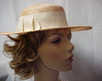 Wide brim beige straw hat from NEIMAN MARCAS- fits 21 1/2 inches