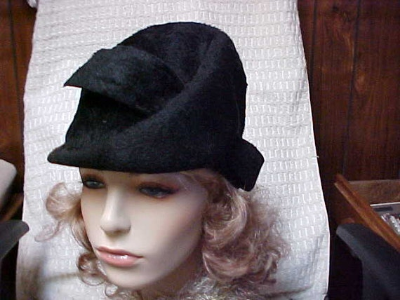Reserved for Tsangse--Imported black fur hat made in Austria size 22 1/2 inches