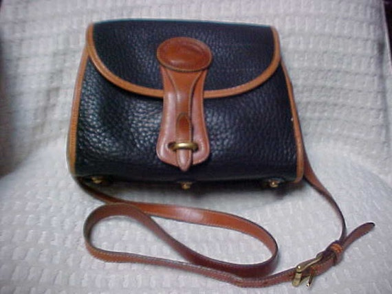 Black and Brown Dooney and Bourke all weather leather purse- excellent