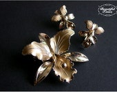 Vintage golden orchid brooch and screwback earrings set.