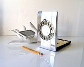 60s Mad Men era chrome phone address book - just dial the wheel for your listing - old school tech - made in Germany