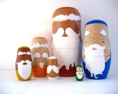 Wooden nesting dolls ... white haired old men