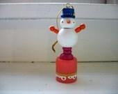 wooden folk art  rubber band bendy push toy ... frosty the snowman