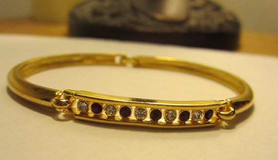 Vintage  1980s Goldtone Bangle Bracelet with Red and White Crystals
