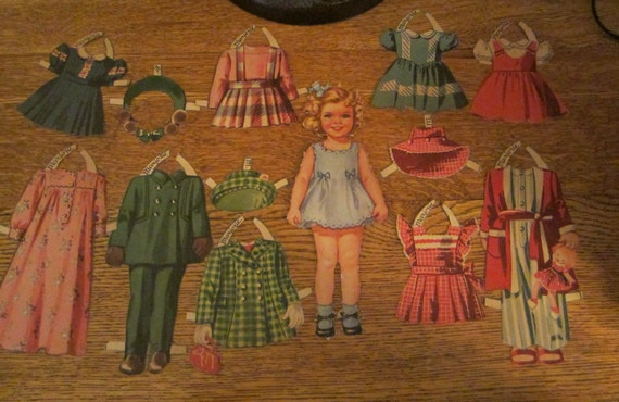Vintage Paper Doll Girl Named Majorie with 9 Outfits