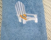 ADIRONDACK BEACH CHAIR WITH STRAW HAT EMBROIDERED ON BLUE HANDTOWEL