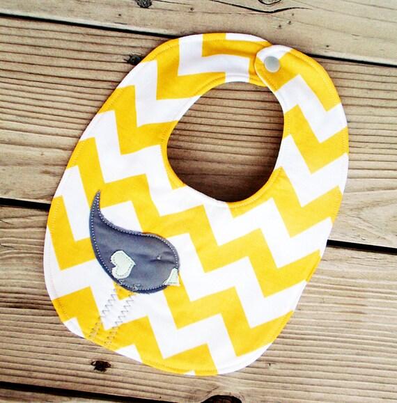 Yellow chevron baby bib with gray birdie