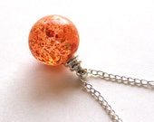 Bright orange paint splatter glass marble silver necklace