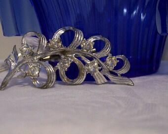 Silver tone and clear rhinestone brooch / pin