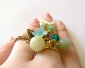 Peacemaker Helen, adjustable dangle cha cha cocktail ring. Pastel blue mint and gold brass. Helen of Troy inspired.