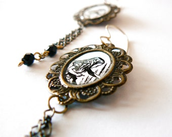 Alice in Wonderland earrings, antique brass and glass beads. Black and white. Long. Altered art. Pop culture. Curiosity.