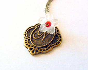 Initial jewelry, monogram necklace, bronze gold tone with a white and red flower. Letter N.