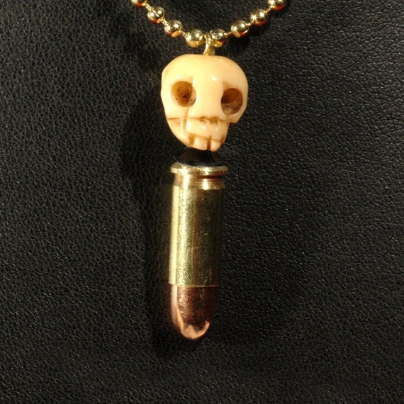 Bone And Bullet - UNISEX  - Antiqued Bone Skull Bullet Necklace - 25 Caliber Bullet Necklace With Carved Bone Skull