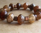 reserved for tania - stretch bracelet - tiger fur agate, copper tubing - tiger in a tube