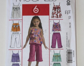 McCall's M5308, Sewing Pattern, Girls size 6-7-8 top, dresses, capri pants, and shorts, UNCUT, FF,  International Shipping