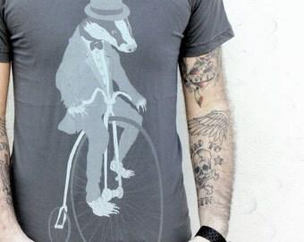 Badger on a Pennyfarthing Bike- Mens T Shirt, Unisex Tee, Cotton Tee, Handmade graphic tee, Bicycle shirt, Bike Tee, sizes xs-xxl