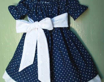 Girl dress navy blue dot with eyelet trim and sash