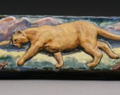 Mountain Lion Roaming with blue border Aprox. Size. 6x2''