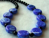 50% off Ocean blue glass beads with black veins necklace and matching earrings